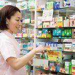Registered Vendor of Drugstore Placing Medicine on Shelf