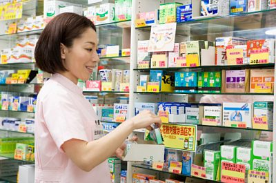 Registered Vendor of Drugstore Placing Medicine on Shelf